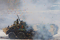 Krasnoarmeysk, Moscow Region, Russia, 29/10/2010..An armoured personnel carrier is showered with confetti from fireworks during a Russian special forces training at a military base outside Moscow. The exercise was part of the Interpolitex 2010 state security exhibition.