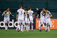 Federico Higuain (10) of the Columbus Crew celebrates his goal with teammate Michael Parkhurst (4) during a MLS game at RFK Stadium in Washington, DC.  D.C. United lost to the Columbus Crew, 3-0.