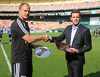 DC United Head Coach Ben Olsen and AFC Ajax Head Coach Frank de Boer exchanging plaques at the beginning of the game.   AFC Ajax defeated DC United 2-1 during an International Friendly at RFK Stadium Sunday May 22, 2011.