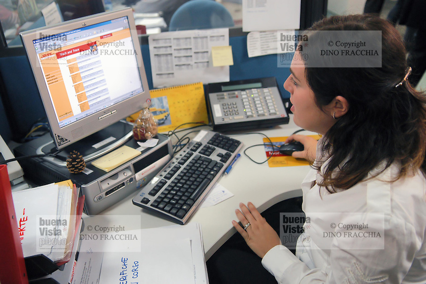- Milano (Italy), call-center del corriere DHL per l'assistenza ai clienti....- Milan (Italy), call-center of  DHL courier for customers assistance and help