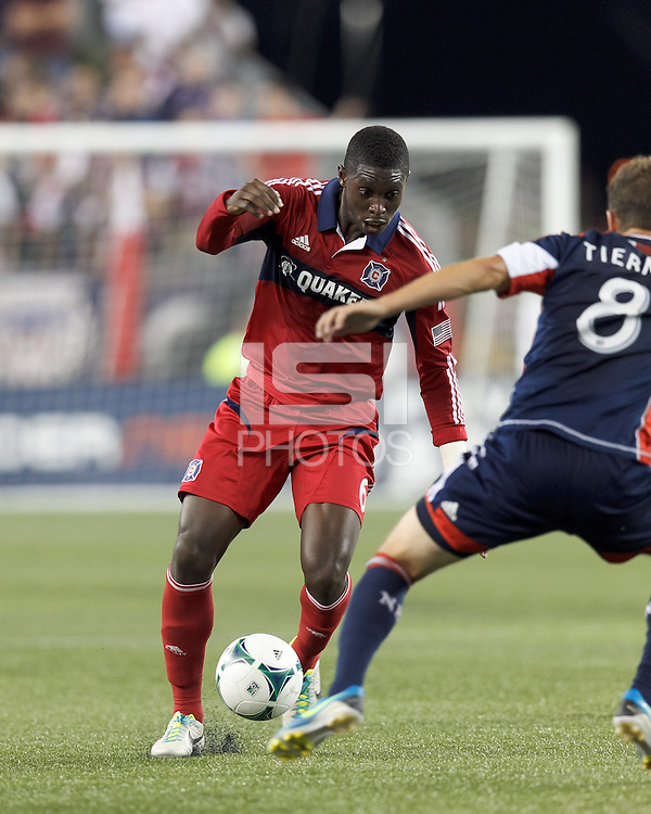 Chicago Fire defender Jalil Anibaba (6) dribbles. In a Major League Soccer (MLS) match, the New England Revolution (blue) defeated Chicago Fire (red), 2-0, at Gillette Stadium on August 17, 2013.