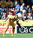 MOTHERWELL'S MICHAEL HIGDON  AND RANGERS' JORDAN MCMILLAN CHALLENGE FOR THE BALL