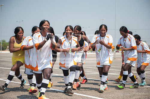 The Kayapo women's football team celebrate their 3-2 win against the Xavante team with a traditional ceremonial dance at the International Indigenous Games in Brazil. 22nd October 2015