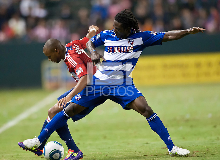 CARSON, CA – June 18, 2011: FC Dallas defender Ugo Ihemelu (3) shields the ball from Chivas USA forward Tristan Bowen (7) during the match between Chivas USA and FC Dallas at the Home Depot Center in Carson, California. Final score Chivas USA 1, FC Dallas 2.