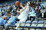 25 November 2012: North Carolina's Megan Buckland saves the ball from going out of bounds. The University of North Carolina Tar Heels played the UNC Asheville Bulldogs at Carmichael Arena in Chapel Hill, North Carolina in an NCAA Division I Women's Basketball game. UNC won the game 101-42.