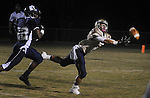 Alonso's #7 Brandon Robinson misses the catch in front of Wharton's #22 Jermey Jefferson during the first half of a game at Wharton High Friday night.