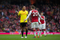 Watford's Troy Deeney has words with Arsenal's Shkodran Mustafi <br /> <br /> Photographer Craig Mercer/CameraSport<br /> <br /> The Premier League - Sunday 11th March 2018 - Arsenal v Watford - The Emirates - London<br /> <br /> World Copyright &copy; 2018 CameraSport. All rights reserved. 43 Linden Ave. Countesthorpe. Leicester. England. LE8 5PG - Tel: +44 (0) 116 277 4147 - admin@camerasport.com - www.camerasport.com
