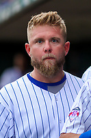 Iowa Cubs catcher Taylor Davis (19) stares at the camera between innings during a Pacific Coast League game against the Colorado Springs Sky Sox on June 22, 2018 at Principal Park in Des Moines, Iowa. Iowa defeated Colorado Springs 4-3. (Brad Krause/Four Seam Images)