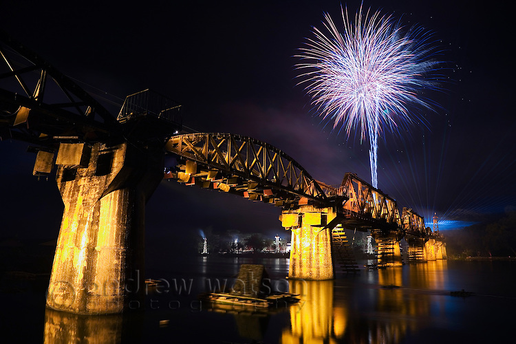 Fireworks explode over the the infamous Death Railway Bridge (Bridge over the River Kwai) during the River Kwai Bridge Week festival.  Kanchanaburi, Kanchanaburi, THAILAND