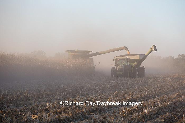 63801-06708 John Deere combine harvesting corn while unloading corn into wagon, Marion Co., IL