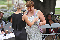 (Photo by John Valenzuela, Freelance)<br /> <br /> Lavender (LGBTQIA+) Graduation Celebration in the Academic Quad, May 18, 2018.<br /> <br /> Cultural Graduation Celebrations are an opportunity for smaller groups to come together and acknowledge students' accomplishments with family and friends while celebrating the rich diversity of our campus. The Office of Intercultural Affairs partners with cultural organizations to coordinate the events.<br /> <br /> (Photo by John Valenzuela, Freelance)