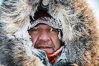 Allen Moore is frosted up on his arrival in the morning at the checkpoint in Manley Hot Springs.  This is the second checkpoint of the 2015 Iditarod.<br /> <br /> (C) Jeff Schultz/SchultzPhoto.com - ALL RIGHTS RESERVED<br />  DUPLICATION  PROHIBITED  WITHOUT  PERMISSION