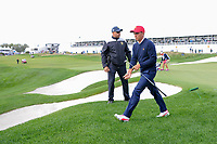 Rickie Fowler (USA) departs 14 during round 3 Foursomes of the 2017 President's Cup, Liberty National Golf Club, Jersey City, New Jersey, USA. 9/30/2017.<br /> Picture: Golffile | Ken Murray<br /> <br /> All photo usage must carry mandatory copyright credit (&copy; Golffile | Ken Murray)