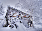 Very old log cabin in Old Town, covered in snow and frost.