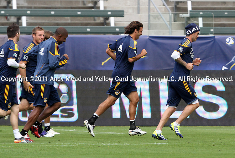 19 November 2011: David Beckham (ENG) (right) leads the team in a lap around the field. The Los Angeles Galaxy held a practice session at the Home Depot Center in Carson, CA one day before playing in MLS Cup 2011.