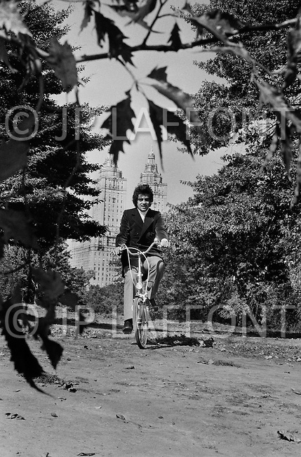 New York City, USA. October 1st, 1971. Enrico Macias rides a bicycle in New York City's Central Park.