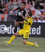 D.C. United forward Dwayne De Rosario (7) goes against Columbus Crew defender Carlos Mendes (4)  D.C. United defeated The Columbus Crew 1-0 at RFK Stadium, Saturday August 4, 2012.