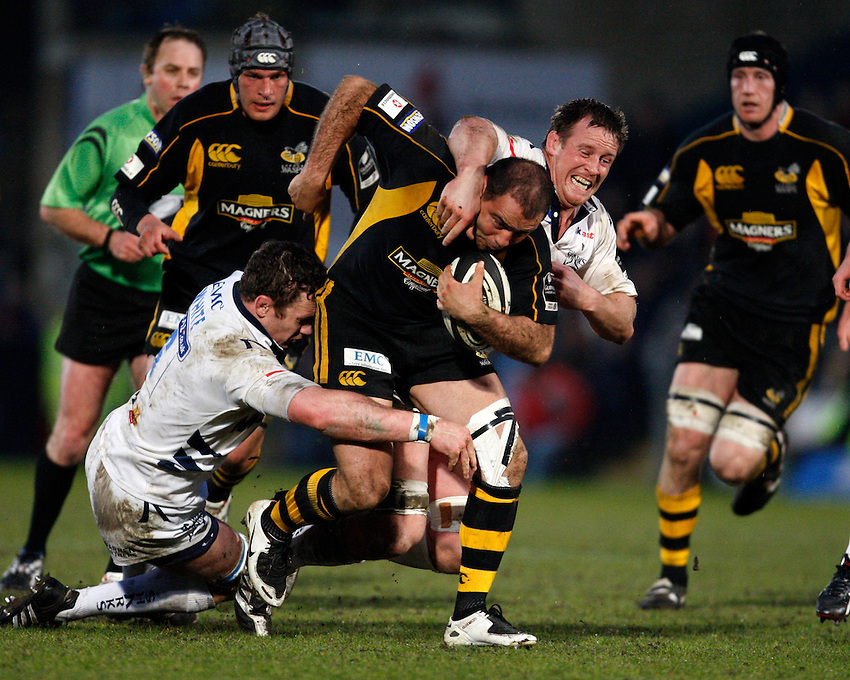 Photo: Richard Lane/Richard Lane Photography..London Wasps v Sale Sharks. Guinness Premiership. 15/04/2008. Wasps' Raphael Ibanez is tackled by Sale's Jason White and Dean Schofield.