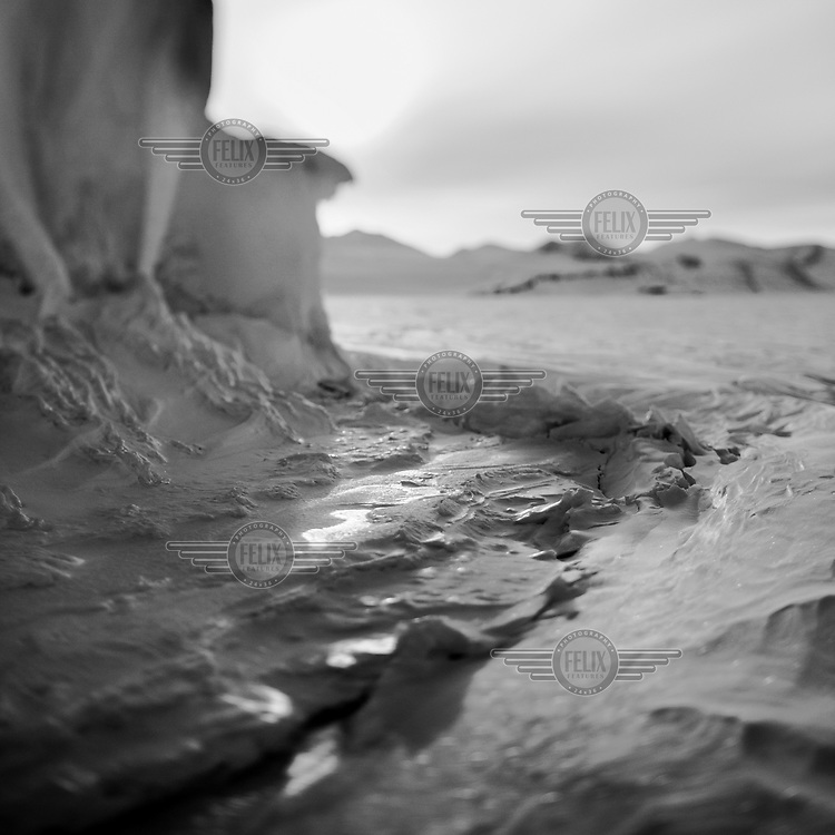 And ice and snow bound landscape near Daneborg. Established on the east coast of Greenland in 1950, Daneborg is the base for the Sirius Patrol, a Danish navy unit which patrols and enforces Danish sovereignty in the Arctic regions of Northern and Eastern Greenland.