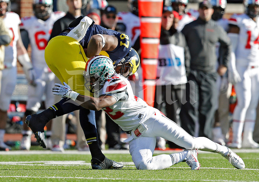 Ohio State Buckeyes cornerback Doran Grant (12) tackles Michigan Wolverines tight end Devin Funchess (87) in the 3rd quarter of their college football game at Michigan Stadium in Ann Arbor, Michigan on November 30, 2013.  (Dispatch photo by Kyle Robertson)