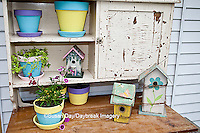 63821-201.08 Potting bench with containers, birdhouse and flowers in spring, Marion Co. IL