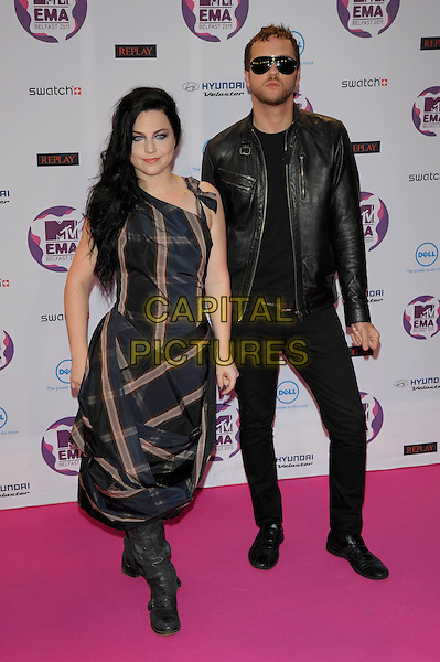 Evanescence: Amy Lee, Ben Moody.MTV European Music Awards EMA red carpet arrivals, Odyssey Arena, Belfast, Northern Ireland..6th November 2011.full length black dress leather jacket jeans denim blue navy check dress sunglasses shades .CAP/PL.©Phil Loftus/Capital Pictures.