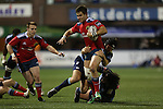 Blues pair Adan Thomas and Adam Jones tackle Munster wing Gerhard van den Heever.<br /> Guiness Pro12<br /> Cardiff Blues v Munster<br /> Cardiff Arms Park<br /> 01.11.14<br /> ©Steve Pope-SPORTINGWALES
