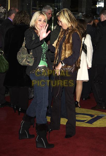 "NATALIE APPLETON & NICOLE APPLETON.""Alfie"" film premiere.Empire cinema, Leicester Square.14 October 2004..full length waving.Ref: PL.www.capitalpictures.com.sales@capitalpictures.com.©Capital Pictures."