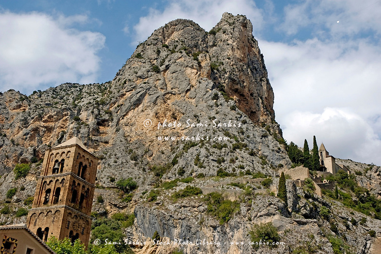 Bell tower of the Notre Dame de Beauvoir chapel and rocky cliffs, Moustiers-Sainte-Maire, Provence, France.