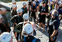 28 JUN 2012 - LONDON, GBR - Referee Howard Vine explains the reason for the delay of the start of the elite men's 2012 Canary Wharf Triathlon first heat at Canary Wharf in London, Great Britain .(PHOTO (C) 2012 NIGEL FARROW)