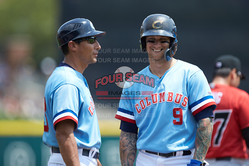 Columbus Clippers third base coach Bobby Magallanes shares a laugh with Brandon Barnes (9) during the game against the Indianapolis Indians at Huntington Park on June 17, 2018 in Columbus, Ohio. The Indians defeated the Clippers 6-3.  (Brian Westerholt/Four Seam Images)