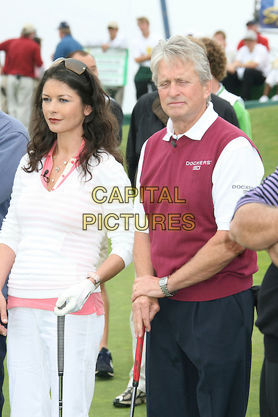 CATHERINE ZETA-JONES & MICHAEL DOUGLAS.9th Annual Michael Douglas & Friends Celebrity Golf Event.held at the Trump National Golf Club, Rancho Palos Verdes, California, USA. .April 29th, 2007.sport half length white pink striped stripes top cropped married husband wife couple beige vest sleeveless jumper.CAP/ADM/RE.©Russ Elliot/AdMedia/Capital Pictures