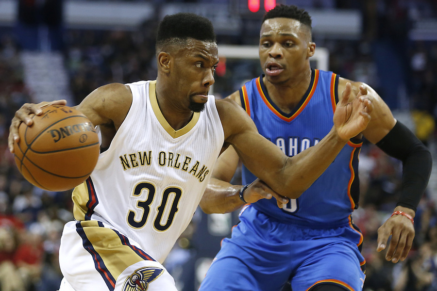 New Orleans Pelicans guard Norris Cole (30) drives against Oklahoma City Thunder guard Russell Westbrook (0) during the first half of an NBA basketball game Thursday, Feb. 25, 2016, in New Orleans. (AP Photo/Jonathan Bachman)