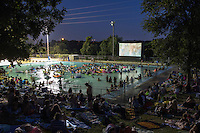 During Deep Eddy Pool Splash Movie Night Pool-goers enjoy the latest movie releases and old favorites while wading and floating in the refreshing 70-degree water at Deep Eddy Pool in Austin, Texas.