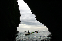 SANTA CRUZ ISLAND,CA - OCT. 26, 2007: A kayakers explore Santa Cruz's seacaves, october, 26, 2007. Santa crz island is the largest of the islands off the California coast and is a favored destination in the Channel Islands National Park.