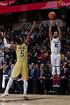 Mitchell Wilbekin (10) of the Wake Forest Demon Deacons shoots over Josh Okogie (5) of the Georgia Tech Yellow Jackets during second half action at the LJVM Coliseum on February 14, 2018 in Winston-Salem, North Carolina.  The Demon Deacons defeated the Yellow Jackets 79-62.  (Brian Westerholt/Sports On Film)