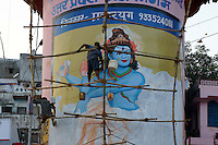 wall painting of supreme god Shiva  in process at main ghat at river Ganges in Varanasi