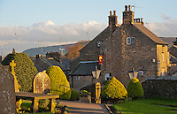 View of Chipping village from the churchyard, Lancashire with evening autumn light.