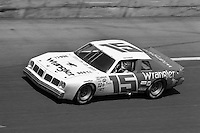 DAYTONA BEACH, FL - FEBRUARY 14: Dale Earnhardt drives the Bud Moore Ford through the Turn 4 banking during the Daytona 500 NASCAR Winston Cup race at the Daytona International Speedway in Daytona Beach, Florida, on February 14, 1982.