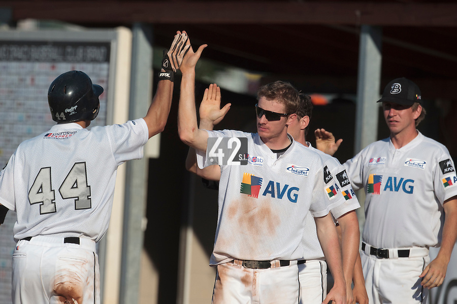 06 June 2010: #44 Michal Ondracek of AVG Draci Brno is congratulated by teammates during the 2010 Baseball European Cup match won 10-8 by the Rouen Huskies over AVG Draci Brno, at the AVG Arena, in Brno, Czech Republic.