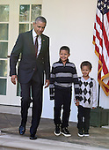"""United States President Barack Obama, left, joined by nephews Austin Robinson, 6, center, and Aaron   Robinson, 4, right, arrives in the Rose Garden to pardon the 2016 National Thanksgiving Turkey, Tater, and its alternate Tot, during a ceremony at the White House in Washington, DC on Wednesday, November 23, 2016.  This is the 69th anniversary of this honored tradition began in 1947 by President Harry S Truman.  Once pardoned the birds will be sent to their new home at Virginia Tech's Animal and Poultry Sciences Department at """"Gobbler's Rest"""" in Blacksburg, Virginia where they will be cared for by students and veterinarians.<br /> Credit: Ron Sachs / CNP"""