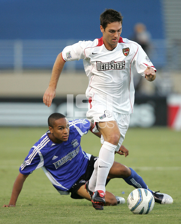 23 July 2005: Ante Razov of MetroStars dribbles the ball away from Ricardo Clark of Earthquakes during the second half of the game at Spartan Stadium in San Jose, California.  Earthquakes defeated MetroStars, 2-1.