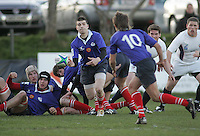 Russian scrum half Gleb Babkin gets his pass away to Justin Petrushka during the IRB U19 World Championship Division B first round match played at Gibson Park, Belfast. Result Russia 0 USA 6.