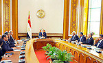 Egyptian President Abdel Fattah al-Sisi meets with members of the newly appointed cabinet, in the capital Cairo on March 23, 2016. Sisi swore in 10 new ministers in a cabinet reshuffle, as Egypt struggles to revive an economy battered by falling tourism revenues and foreign investments. The government shake-up -- mainly of economic portfolios -- comes just six months after Sisi inaugurated a new administration led by Prime Minister Sharif Ismail, following the resignation of the previous cabinet after a corruption scandal. Photo by Egyptian President Office