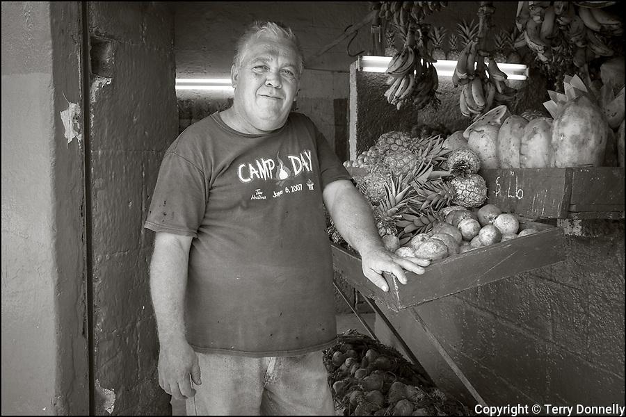 Regla, Havana, Cuba:<br /> Street scene with vegetable market vendor in the Regla nieghborhood