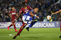 BOGOTÁ - COLOMBIA, 06-02-2020: Ayron Del Valle de Millonarios  disputa el balón con Marc Enoumba de Always Ready  durante partido entre Millonarios de Colombia y Always Ready  de Bolivia por la primera fase, ida, de la Copa CONMEBOL Sudamericana 2020 jugado en el estadio Nemesio Camacho El Campín  de la ciudad de Bogotá. /Ayron Del Valle of Millonarios  vies for the ball with Marc Enoumba of Aways Ready  during match between Millonarios  of Colombia and Always Ready  of Bolivia for the first phase as part of Copa CONMEBOL Sudamericana 2020 played at Nemesio Camacho El Campin stadium of Bogota city. Photo: VizzorImage / Felipe Caicedo / Staff