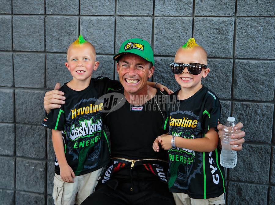Jun 17, 2018; Bristol, TN, USA; NHRA top fuel driver Clay Millican (center) poses for photo with young fans during the Thunder Valley Nationals at Bristol Dragway. Mandatory Credit: Mark J. Rebilas-USA TODAY Sports