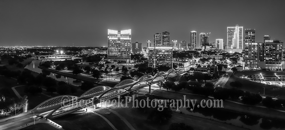 We capture this aerial black and white panorama image at twilight of the Fort Worth skyline with the Seventh Street bridge as it crosses the Trinity River in downtown. The 7th street bridge was lighted with purple led light so it really popped in this image of the cityscape. The seventh street bridge led light seem to change colors every day so that was a nice treat. Fort Worth is the fifth largest city in Texas. Ft Worth is located in central north part of Texas and the county seat is Tarrant County. The latest census is that the population for Fort Worth is estimates, at around 854,113. The city is the second-largest in the Dallas–Fort Worth–Arlington metropolitan area or the DFW Metro.