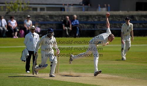 Aberdeenshire CC V Grange CC, Lloyds TSB Scottish Cup, played at Mannofield, Aberdeen - 'Shire fast bowler Chris West in full flow past Grange capt Sanjay Patel - Picture by Donald MacLeod 21.06.09