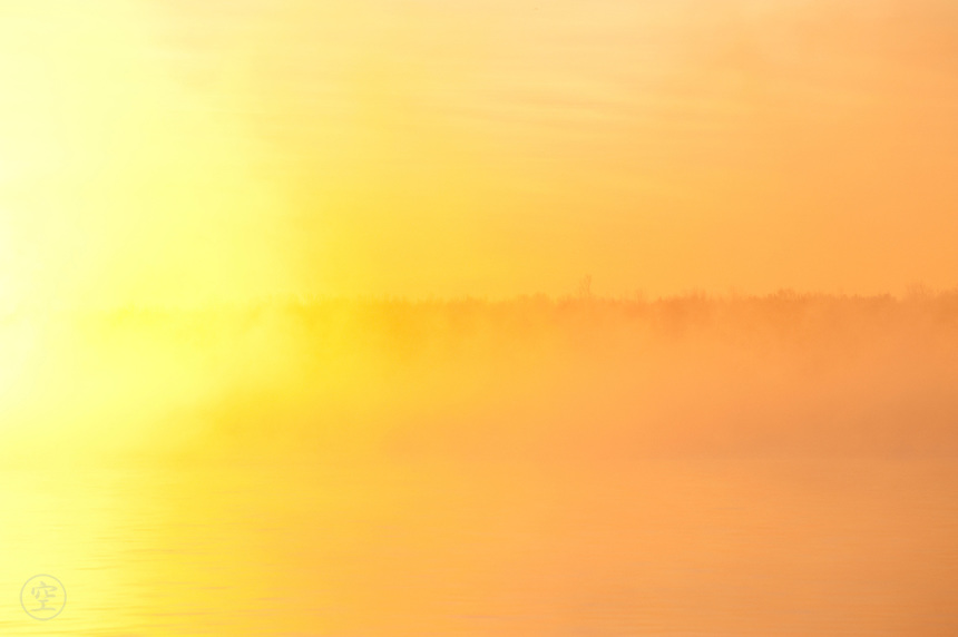 Sunrise over the Saint Lawrence River on a misty morning over the Southern Shore of the River, Iroquois, Ontario, Canada.